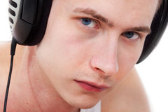 HEADPHONES. man listening to music stock photography