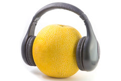 Headphones on melon Royalty Free Stock Images
