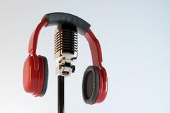 Headphones and mic, audio concept Stock Image