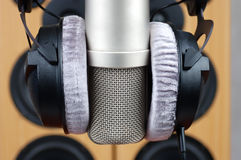 Headphones and microphone. In sound studio on a background of acoustic systems stock photos