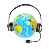 Headphones with a microphone and a globe Stock Images