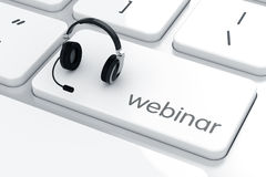 Headphones with microphone on the keyboard. Webinar concept Royalty Free Stock Image