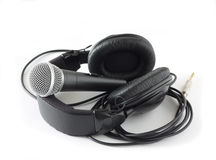 Headphones and microphone over white Royalty Free Stock Photos