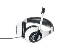 Headphones with microphone side view on white Royalty Free Stock Image