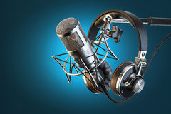 Headphones on microphone stand Royalty Free Stock Images