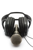Headphones and microphone   on white background Stock Images