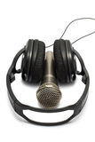 Headphones and microphone on white background Royalty Free Stock Image