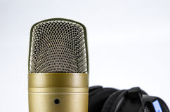 Headphones and Microphone on a White Background. Stock Photo