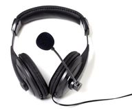 Headphones with microphone on white background. Royalty Free Stock Photo