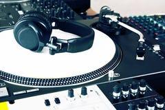 Headphones, mixer and turntable. Top-class audio equipment for a hip-hop scratch Dj Royalty Free Stock Photos
