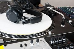 Headphones, mixer and turntable. Top-class audio equipment for a hip-hop scratch Dj Stock Photography