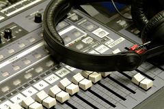 Headphones & Mixing Desk Royalty Free Stock Photography