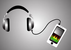 Headphones and mobile phone with playing music on the silver background closeup. Stock Images
