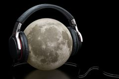 Headphones with moon, 3D rendering isolated on black background. Headphones with moon, 3D rendering isolated on black backdrop Stock Photo