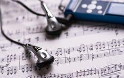 Headphones and MP3 player Stock Photo