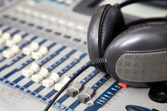 Headphones On Music Mixer In Studio. Closeup of headphones on music mixer in studio Royalty Free Stock Photography