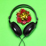 Christmas party music - Xmas songs minimal concept. Headphones and New Year decorations. Christmas party music playlist. Xmas songs minimal concept royalty free stock images