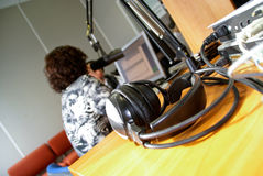 Headphones in news room Stock Images
