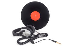 Headphones next to vinyl records Royalty Free Stock Photo