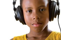 Headphones nightcap. A tired boy enjoys listening to soothing music on headphones - late at night stock photo