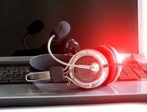 Headphones on notebook keyboard Stock Images
