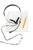Headphones and notepad Stock Images