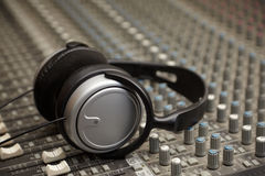 Headphones on old dirty sound mixer pult Royalty Free Stock Photos