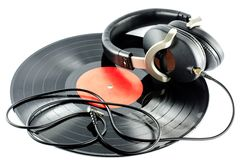 Headphones on old disc. Music concept Stock Images