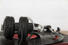Headphones on an old retro record player Royalty Free Stock Images