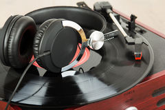 Headphones on an old retro record player Stock Image