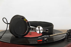 Headphones on an old retro record player Stock Photography