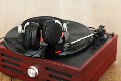 Headphones on an old retro record player Royalty Free Stock Photos
