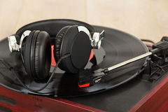 Headphones on an old retro record player Stock Photos