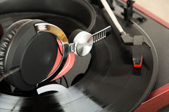 Headphones on an old retro record player Royalty Free Stock Photography