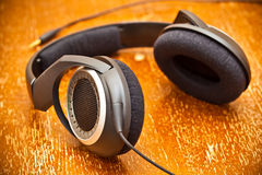 Headphones on old vintage board Royalty Free Stock Image