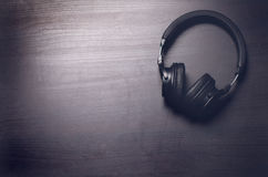 Free Headphones On A Dark Background. Music Accessories. Bluetooth Headphones Without Cable. Stock Photography - 83679592