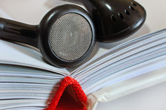 Headphones on open book Royalty Free Stock Photography
