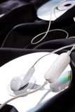 Headphones over compact disc Stock Photo
