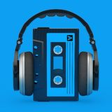 Headphones Over Old Vintage Audio Cassette Tape. 3d Rendering. Headphones Over Old Vintage Audio Cassette Tape on a blue background. 3d Rendering royalty free illustration