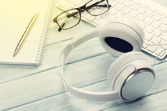Headphones, pc keyboard and notepad Royalty Free Stock Photo