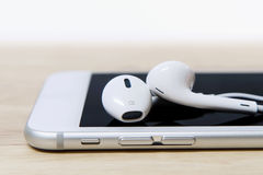 Headphones and phone. Royalty Free Stock Image