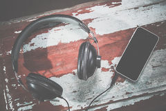Headphones and phone vintage photos, listen to music Royalty Free Stock Photos