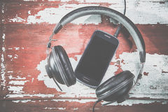 Headphones and phone vintage photos, listen to music Royalty Free Stock Photo