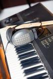 Headphones On Piano In Studio Stock Photo