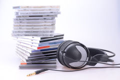 Headphones with a pile of CDs Stock Images