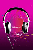 Headphones on pink Stock Photography