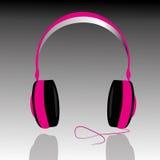 Headphones. Pink headphones on gray background Royalty Free Stock Photography