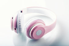 Headphones. Pink Headphones with jack connector - mirror reflection Stock Images