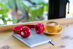 headphones are placed on wooden boards. Ready to w stock image