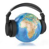 Headphones on planet Earth. Royalty Free Stock Photography